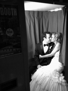 Sharing a private moment in our vintage photo booth during the reception
