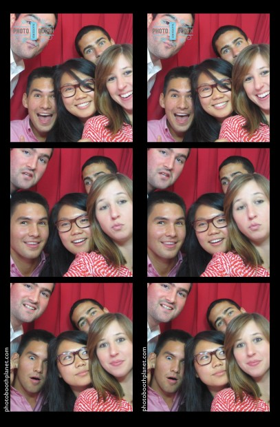 Co-workers enjoying themselves at a holiday party in our photo booth!