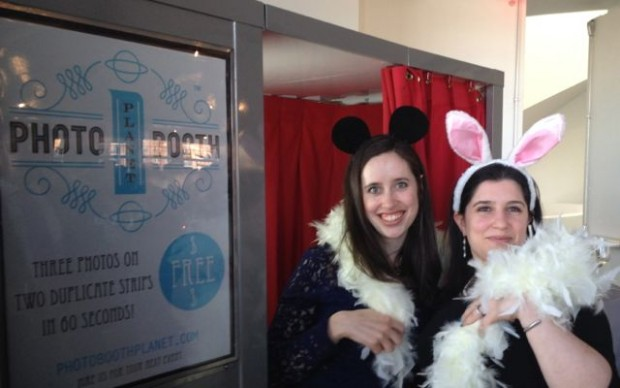Wedding guests posing with props before heading into our vintage photo booth at Maritime Parc.