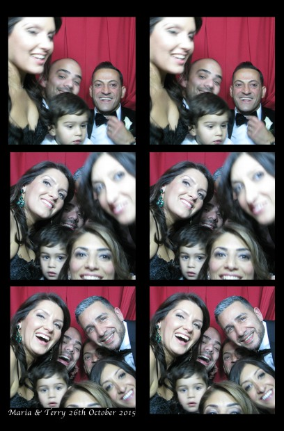 Guests celebrating in our classic photo booth at The Loeb Central Park Boathouse!