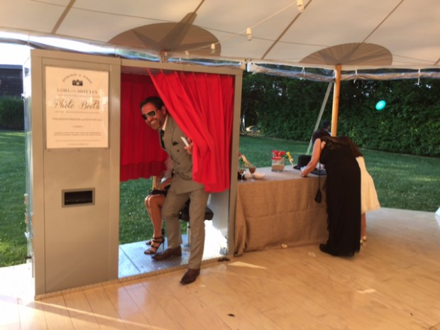 Guests checking out our vintage photo booth at a recent summer wedding at the Gansett Green Manor in Amagansett, NY