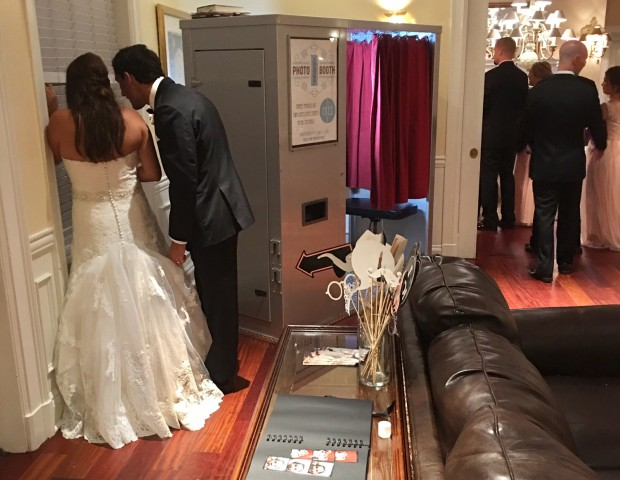 Bride and groom watching introductions.  They rented one of our vintage photo booths for their wedding at Ocean Cliff in Newport RI